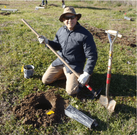 volunteer planting part of a restored riparian forest on Sweeney Creek